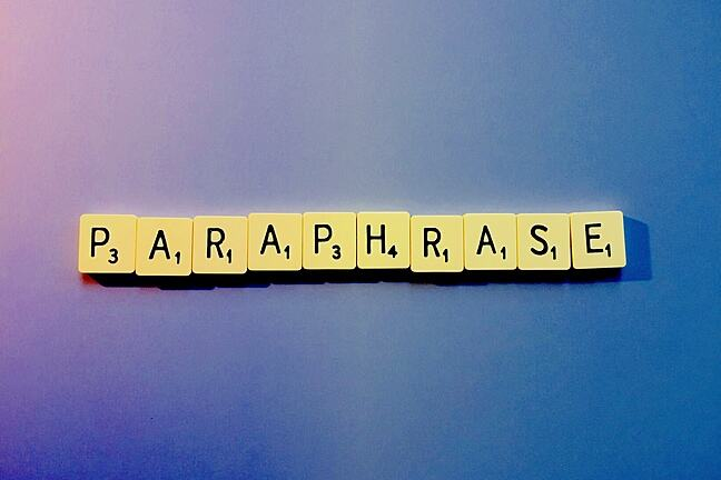 The word 'paraphrase' spelled out in letter tiles.