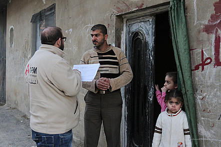 Aid worker helping newly arrived refugees.