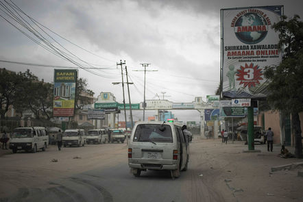 Street scene in Mogadishu with adverts for remittance companies