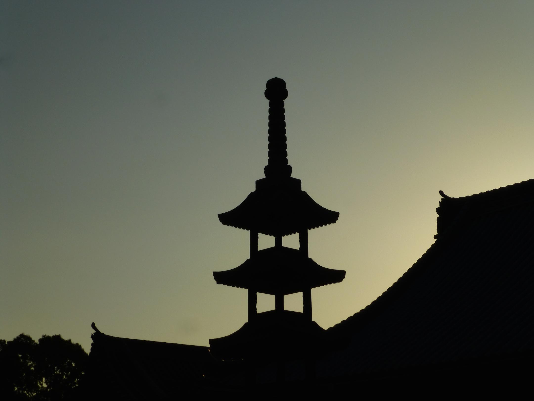 Temple silhouet against sunset sky