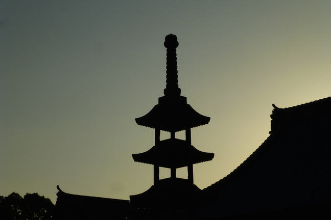 Temple silhouet against sunset sky