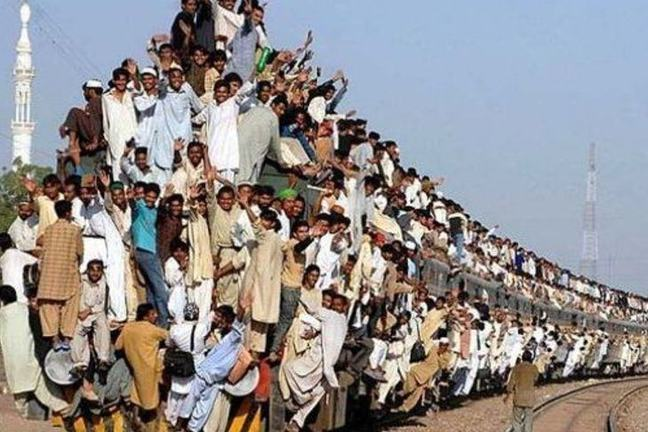Hundreds of people hitching themselves up to the outsides of a train