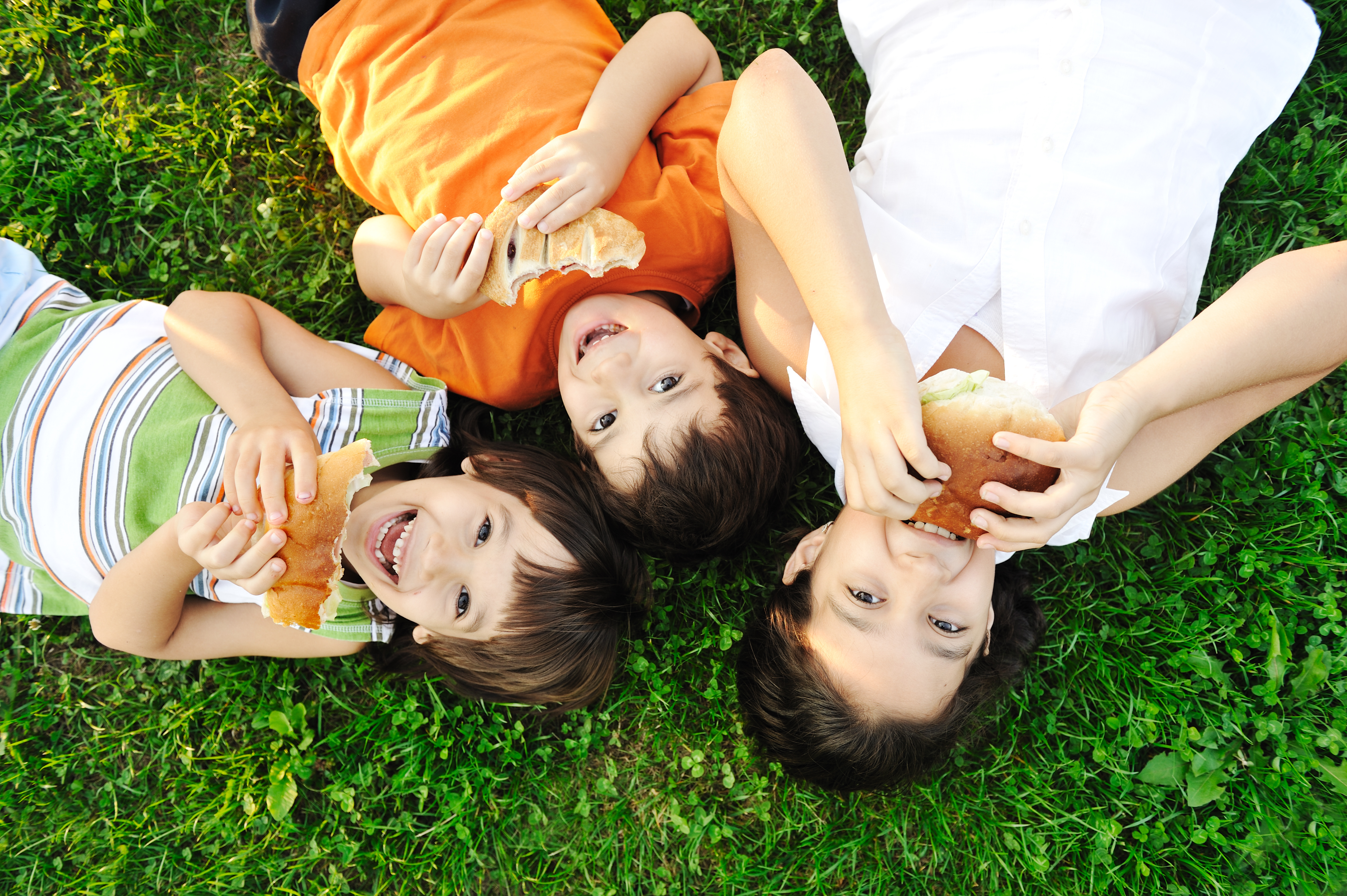 photograph of children eating bread