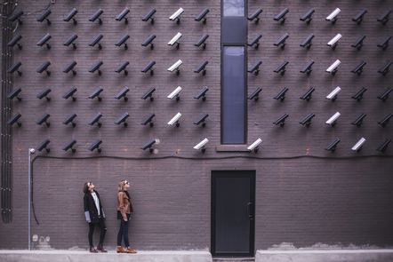 A wall full of CCTV cameras all pointed in the same direction