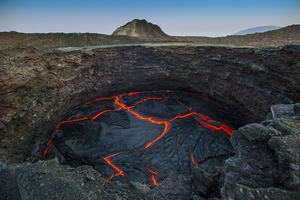 Lava landscape with a volcano