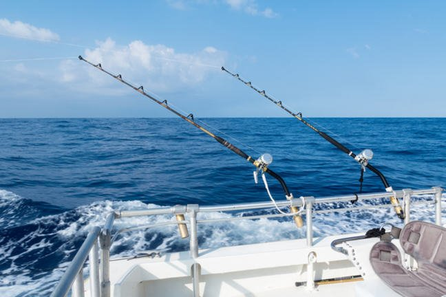 Deep sea sport fishing with rods and reels.
