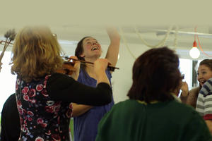 Photograph of people participating in a dance and music session