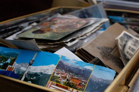 Box full of old photos and postcards