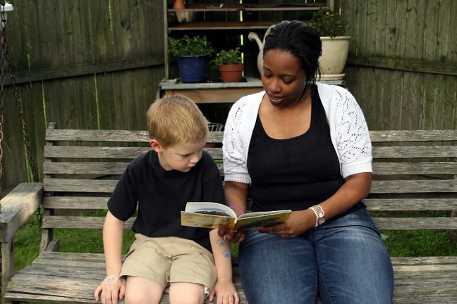woman reads to a child
