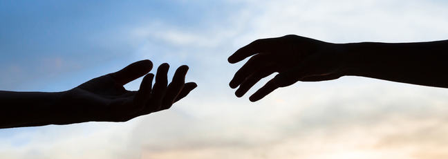 two hands reaching out to touch each other