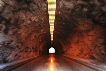 Blurred effect image showing movement towards a tunnel exit