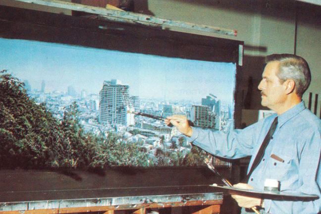 Albert Whitlock painting a scene