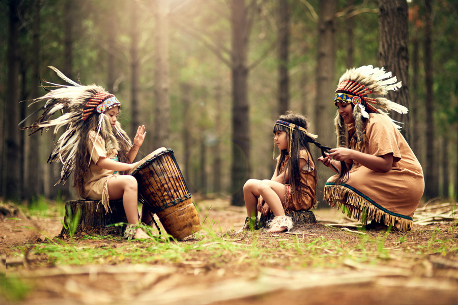 American Indian mother and two daughters with drum