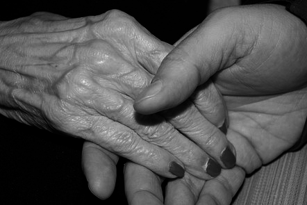 Close up of hands being held
