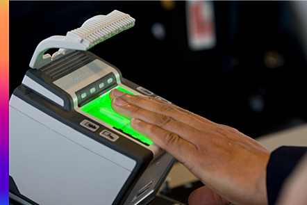 A man scans his hand at an airport access control.