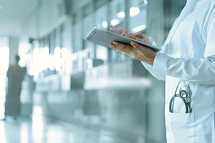 Healthcare and medicine. Medical and technology. Doctor working on digital tablet on hospital background