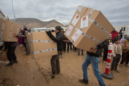 Humanitarian aid is distributed to displaced Iraqis.