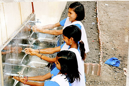 The wash basins at this school are set at different heights for use by girls of different ages.