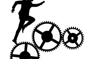 Silhouette of a person climbing some working cogs.