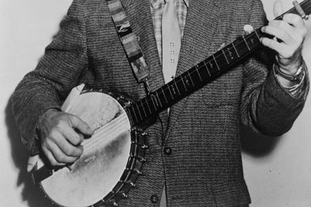 Image of man holding banjo