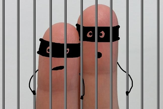 finger figures in a prison cell