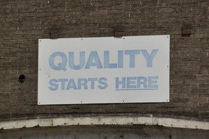 Sign reading 'quality starts here'.