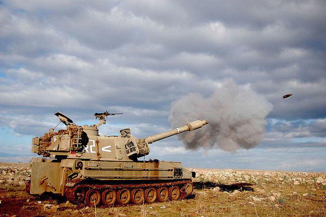 A tank firing a shell