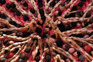A group of people with hands reaching out