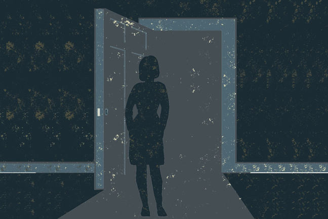 A woman stand at an open doorway but the outside is very dark