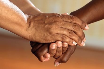 Close up of hands being clasped