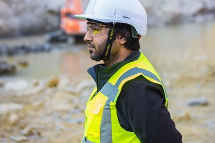 man wearing safety suit standing outdoors