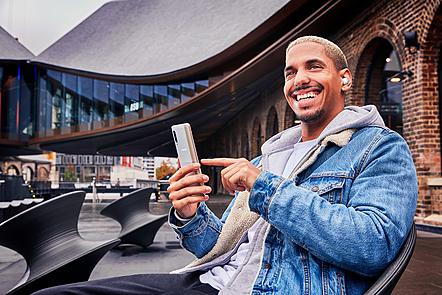 Man smiling using Samsung phone