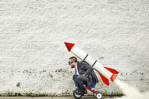 man riding toy rocket