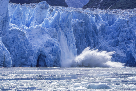 Part of a glacier collapsing into the sea