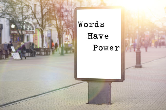 A sign board with text that says 'Words have power'