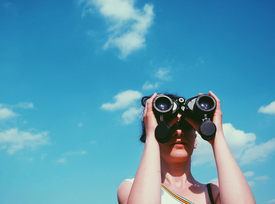 Binoculars to signify the reflective journey