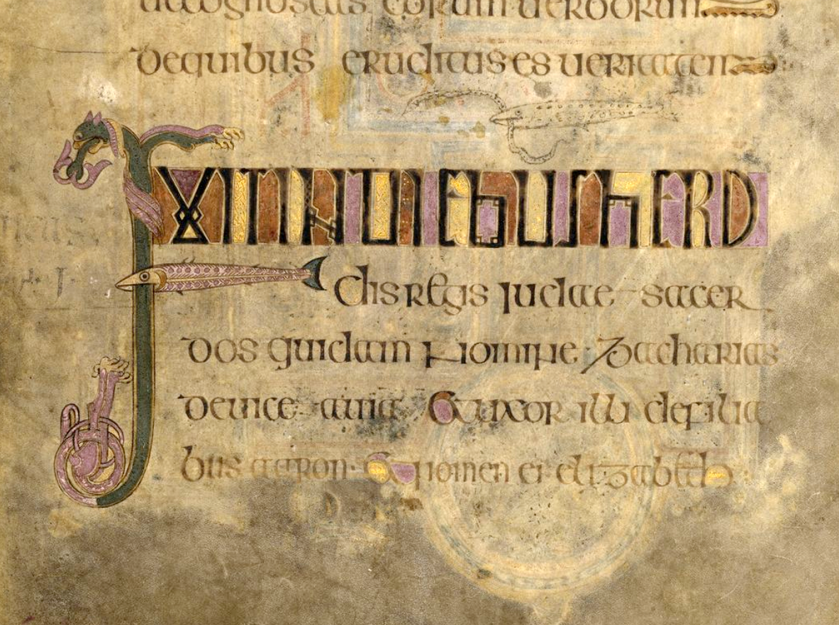 From the Book of Kells, images of fish and a dragon intertwined with text