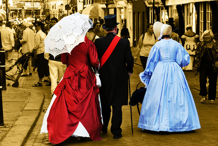 People dressed in Victorian clothing.