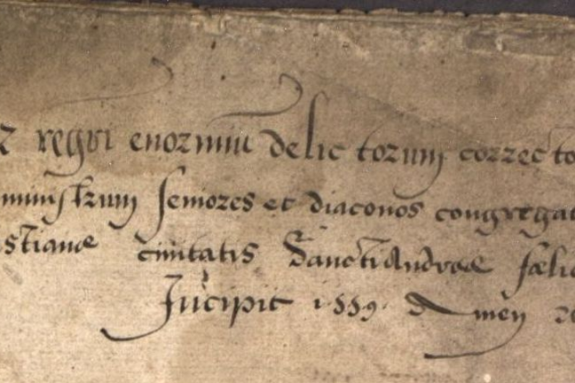 Old paper showing latin preamble in the minute book of St Andrews