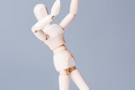 A mannequin stretching