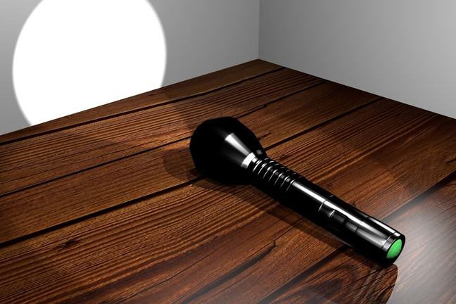 A flashlight on a desk