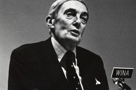 A photograph of Lord Scarman talking into a microphone