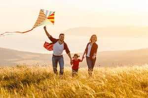 A family flying a kite