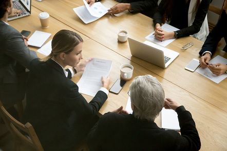 A photo of businesspeople sitting at a table