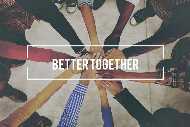 A group of diverse people bringing their hands together. The text is 'Better together'