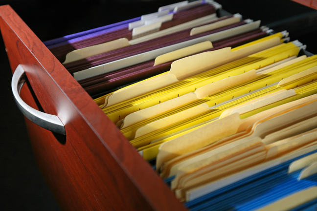 Filing cabinet full of files.