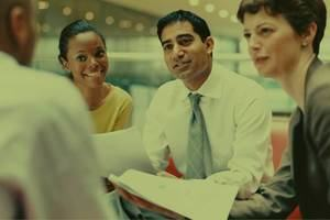 A group of business professionals networking effectively