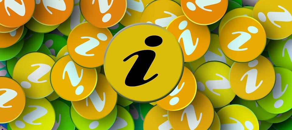 Brightly coloured badges with an 'i' for Information printed on them