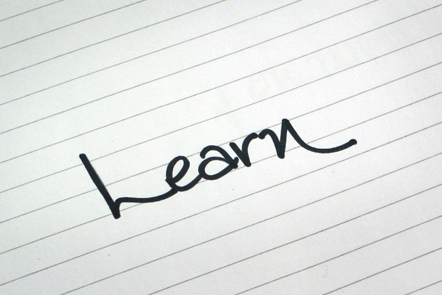 A page with the word 'Learn' written down.
