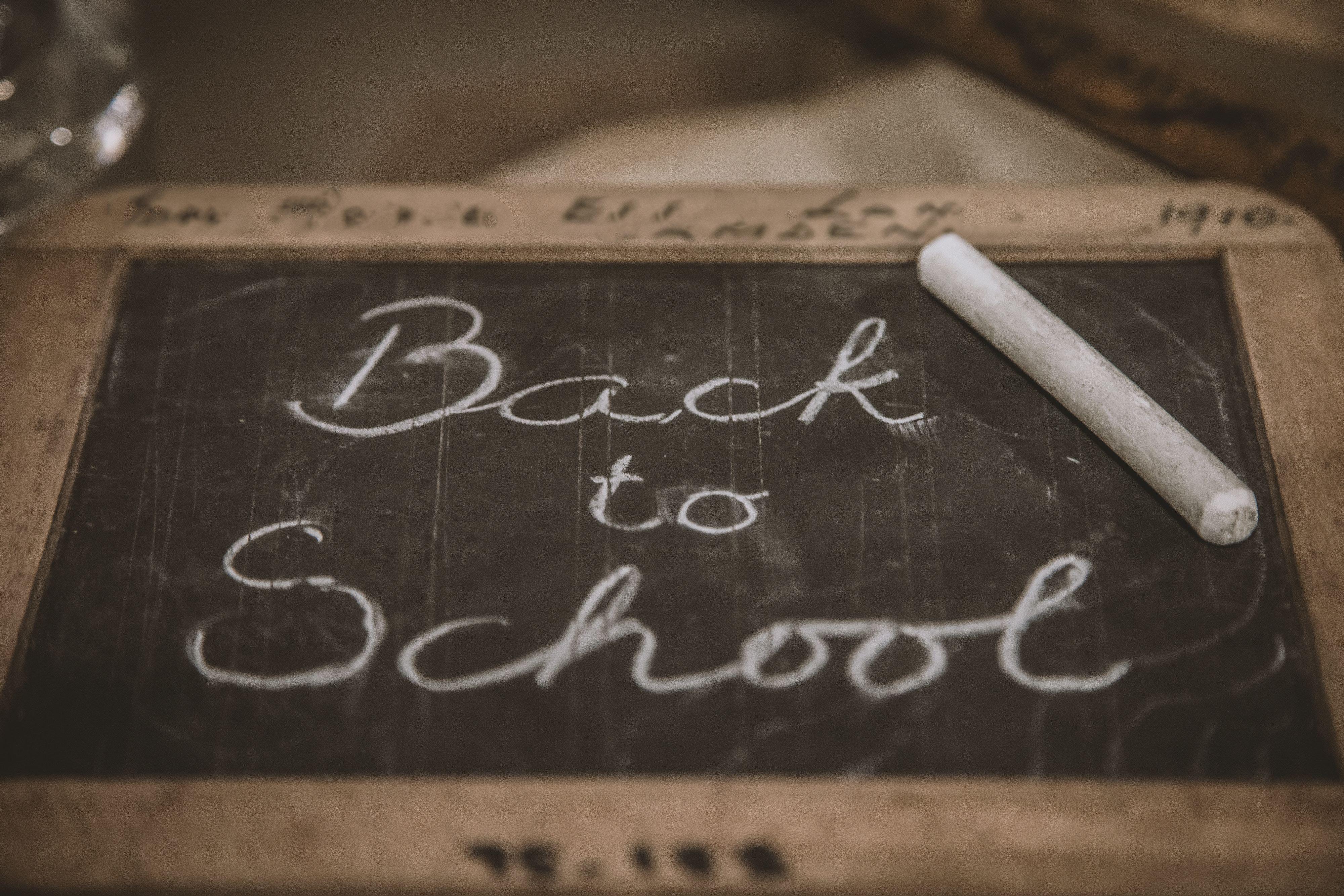 Back to school, written on a blackboard
